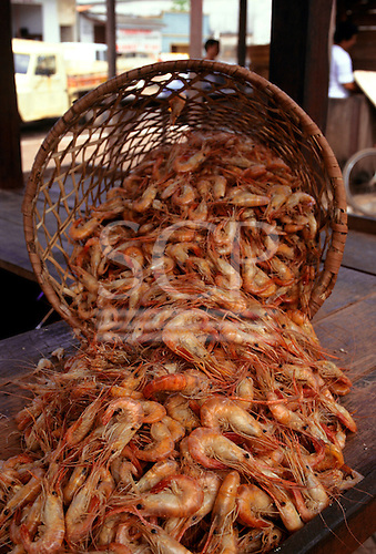 Amapa, Brazil. Large prawns spilling out of a basket in the market at Porto Santana.