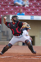 Lansing Lugnuts catcher Seth Conner #34 throws during a game against the Cedar Rapids Kernels at Veterans Memorial Stadium on April 29, 2013 in Cedar Rapids, Iowa. (Brace Hemmelgarn/Four Seam Images)
