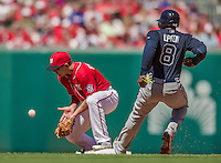 6 April 2014: Washington Nationals infielder Danny Espinosa is unable to corral the ball at second as Justin Upton touches the bag on a Dan Uggla infield hit by the Atlanta Braves at Nationals Park in Washington, DC. The Nationals defeated the Braves 2-1 to salvage the last game of their 3-game series. Mandatory Credit: Ed Wolfstein Photo *** RAW (NEF) Image File Available ***