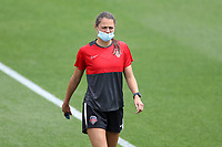 CARY, NC - APRIL 10: Ashley Hatch #33 of the Washington Spirit walks the field after arriving at the stadium before a game between Washington Spirit and North Carolina Courage at Sahlen's Stadium at WakeMed Soccer Park on April 10, 2021 in Cary, North Carolina.