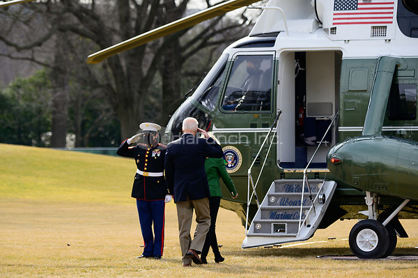 United States President Joe Biden salutes the Marine Guard as he and first lady Jill Biden board Marine One in Washington, D.C., U.S., on Friday, Feb. 26, 2021. Biden is visiting Texas today to discuss recovery efforts after winter weather caused widespread damage and left millions without power.<br /> Credit: Erin Scott / Pool via CNP /MediaPunch