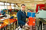 Coláiste Gleann Lí Engineering teacher Mike O'Sullivan preparing heavy duty face masks for Garda Síochána, HSE Covid Unit and other groups using a laser cutting machine