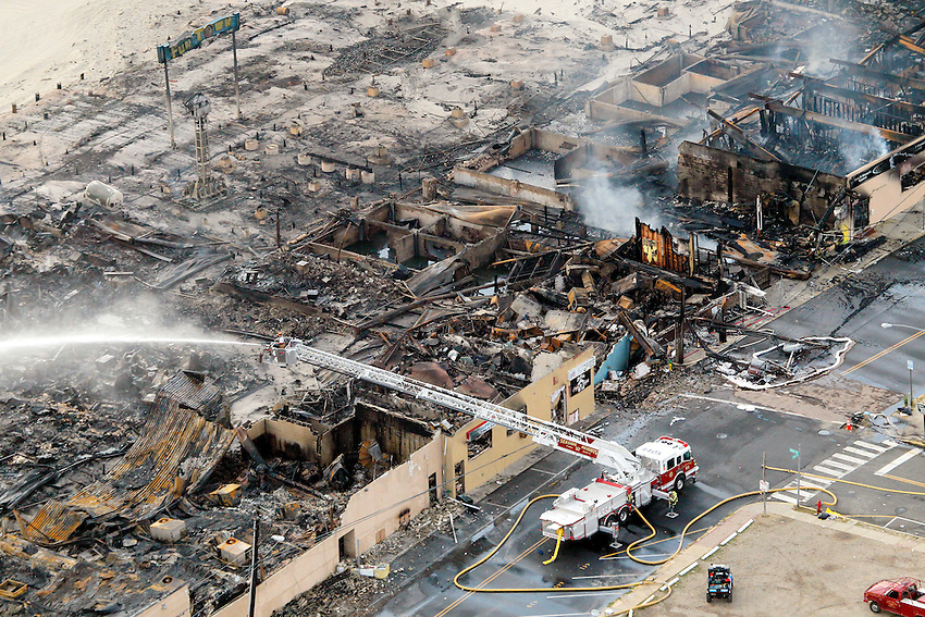 Aerial view of the devastation after a massive fire began yesterday near the Funtown Pier in Seaside Park and spread north, wiping out 4 blocks of boardwalk attractions into Seaside Heights.  9/13/2013 photo ©2013 ANDREW MILLS