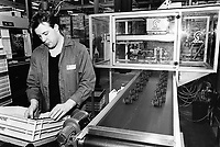 """France. Saône-et-Loire department. Chalon-sur-Saône. Kodak factory. Camera recycling. Male worker. The """"ready to take pictures"""" camera is a small camera commonly described as disposable but in fact assembled for customers to return it after use. After being dismantled, verified and meticulously cleaned, some pieces are reused, other recycled (86%). The plastics parts are torn, melted, recasted and then reassembled. Eastman Kodak Company. Chalon-sur-Saône is located in the south of the Burgundy region. © 1996 Didier Ruef .."""
