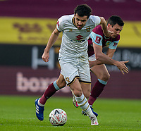 9th January 2021; Turf Moor, Burnley, Lanchashire, England; English FA Cup Football, Burnley versus Milton Keynes Dons; Scott Fraser of MK Dons on the ball as he goes past Jack Cork of Burnley