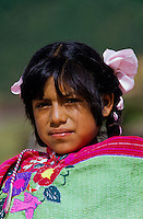 Portrait of smiling Indian girl with hair brases and colorfull traditional dress in Mexico