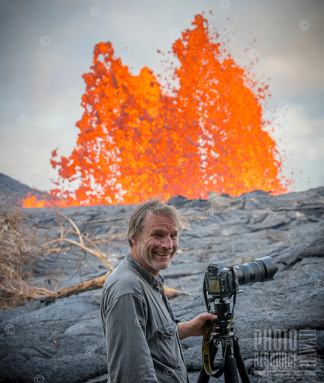 May 2018: A photographer stands close to the Kilauea Volcano eruption in Leilani Estates, Puna, Big Island of Hawai'i.