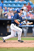 Asheville Tourists right fielder Tyler Bugner (27) swings at a pitch during game one of a double header against the Columbia Fireflies at McCormick Field on August 4, 2018 in Asheville, North Carolina. The Tourists defeated the Fireflies 5-1. (Tony Farlow/Four Seam Images)