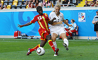 USA's Courtney Verloo (R) and Mantenn Kobblah of Ghana during the FIFA U20 Women World Cup at the Rudolf Harbig Stadium in Dresden, Germany on July 14th, 2010.