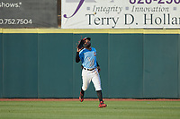 Hickory Crawdads center fielder Miguel Aparicio (5) tracks a fly ball during the game against the Charleston RiverDogs at L.P. Frans Stadium on August 10, 2019 in Hickory, North Carolina. The RiverDogs defeated the Crawdads 10-9. (Brian Westerholt/Four Seam Images)