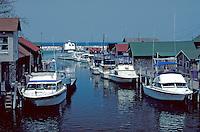 boats along docks at the Lake Michigan resort town. Leland Michigan USA.