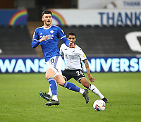 20th March 2021; Liberty Stadium, Swansea, Glamorgan, Wales; English Football League Championship Football, Swansea City versus Cardiff City; Kieffer Moore of Cardiff City passes the ball under pressure from Kyle Naughton of Swansea City