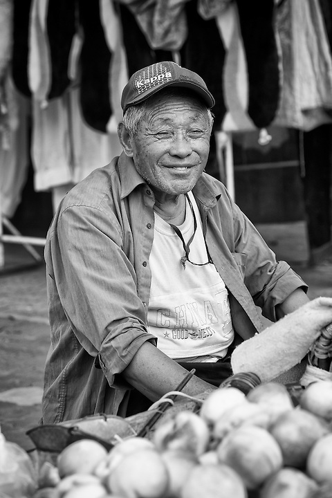 A Hawker Selling Peaches In The Old City Centre, Weihai, China.