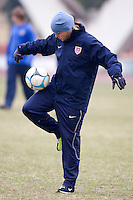 USA defender Cat Whitehill juggles a ball in gloves and hat during a cold practice for the Four Nations Tournament in Guangzhou, China on January 17, 2008.