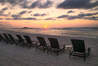 Sunset on beach with beach chairs at Punta Mita, Mexico.