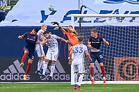 CHICAGO, UNITED STATES - AUGUST 25: Przemyslaw Tyton #22 of FC Cincinnati battles with Robert Beric #27 of Chicago Fire to block the ball during a game between FC Cincinnati and Chicago Fire at Soldier Field on August 25, 2020 in Chicago, Illinois.