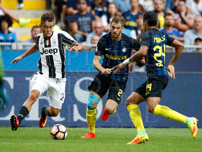 Calcio, Serie A: Inter vs Juventus. Milano, stadio San Siro, 18 settembre 2016.<br /> Juventus' Paulo Dybala, left, is challenged by Inter's Davide Santon, center, and Jeison Murillo, during the Italian Serie A football match between FC Inter and Juventus at Milan's San Siro stadium, 18 September 2016.<br /> UPDATE IMAGES PRESS/Isabella Bonotto