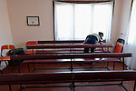 A woman dusts the pews in the United Methodist Church in a largely Turkish-speaking Roma neighborhood of Dobrich, in the northeast of Bulgaria.