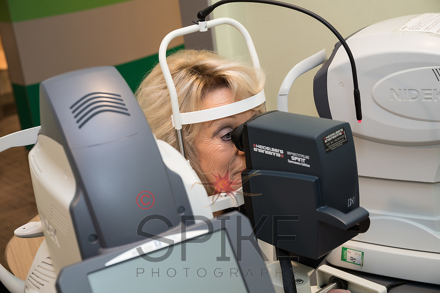 Sherrie Hewson pictured with Clinical Assistant Mia Evans with the new OCT machine