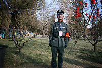 CHINA. A security guard during Chinese New Year in Ditan Park in Beijing.  Chinese New Year, or Spring Festival, is the most important festival and holiday in the Chinese calendar In mainland China, many people use this holiday to visit family and friends and also visit local temples to offer prayers to their ancestors. The roots of Chinese New Year lie in combined influences from Buddhism, Taoism, Confucianism, and folk religions.  2008