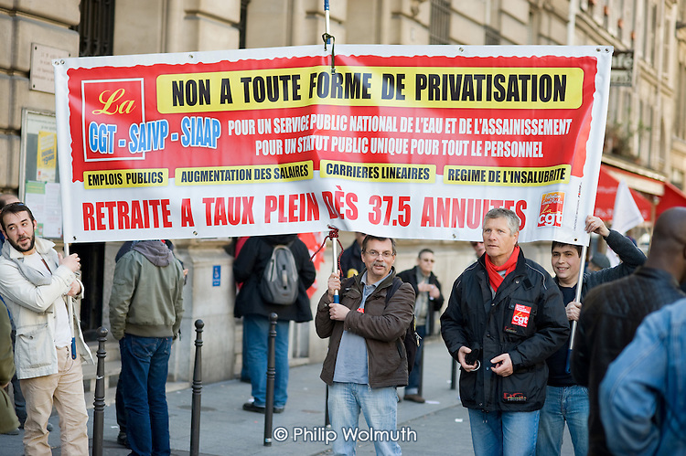 Members of the Paris water union join up to 3 million people across France during a national strike against the Sarkozy government's economic policies.