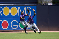 Fort Myers Mighty Mussels outfielders Edouard Julien (31) and Misael Urbina (2) collide on a fly ball caught by Julien during a game against the Tampa Tarpons on May 23, 2021 at George M. Steinbrenner Field in Tampa, Florida.  (Mike Janes/Four Seam Images)