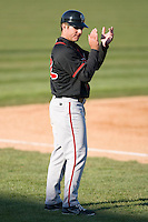 Lansing Lugnuts manager Clayton McCullough #22 encourages his team from the third base coaches box at Coveleski Stadium April 15, 2009 in South Bend, Indiana. (Photo by Brian Westerholt / Four Seam Images)