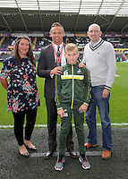 Lee Trundle with Academy youth before the Premier League match between Swansea City and Hull City at the Liberty Stadium, Swansea on Saturday August 20th 2016