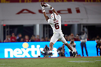 LOS ANGELES, CA - SEPTEMBER 11: Elijah Higgins #6 of the Stanford Cardinal catches a pass from Tanner McKee #18 during a game between University of Southern California and Stanford Football at Los Angeles Memorial Coliseum on September 11, 2021 in Los Angeles, California.