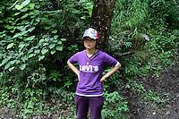 A tourist in the Jiuzhaigou National Park. Sichuan Province. China. 2011