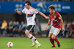 (L) Pierre-Emile Hojbjerg of Bayern Munich being followed by (R) Zheng Zhi of Guangzhou Evergrande during the Bayern Munich vs Guangzhou Evergrande as part of the Bayern Munich Asian Tour 2015  at the Tianhe Sport Centre on 23 July 2015 in Guangzhou, China. Photo by Aitor Alcalde / Power Sport Images