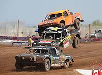 Apr 17, 2011; Surprise, AZ USA; LOORRS driver Rick Huseman (36) leads Todd Leduc (4) and Adrian Cenni (11) during round 4 at Speedworld Off Road Park. Mandatory Credit: Mark J. Rebilas-