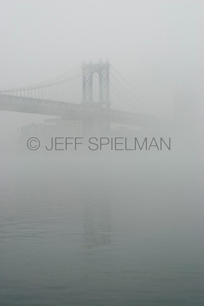 AVAILABLE FROM JEFF AS A FINE ART PRINT.<br /> <br /> AVAILABLE FROM PLAINPICTURE FOR COMMERCIAL AND EDITORIAL LICENSING.  Please go to www.plainpicture.com and search for image # p5690069.<br /> <br /> Manhattan Bridge and East River in the Fog, New York City, New York State, USA