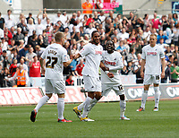 Npower Championship, Swansea City FC (white) V Sheffield United. Sat 7th May 2011 (12.45pm KO)<br /> Pictured L-R: Mark Gower, Ashley Williams and Nathan Dyer celebrate Williams' goal<br /> Picture by: Ben Wyeth / Athena Picture Agency<br /> info@athena-pictures.com<br /> 07815 441513