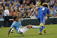 David Luiz (5) Chelsea takes the ball away from Carlos Tevez..Manchester City defeated Chelsea 4-3 in an international friendly at Busch Stadium, St Louis, Missouri.