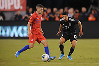 EAST RUTHERFORD, NJ - SEPTEMBER 7: Christian Pulisic #10 of the United States battles for the ball with Jorge Sanchez #21 of Mexico during a game between Mexico and USMNT at MetLife Stadium on September 6, 2019 in East Rutherford, New Jersey.