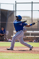 Texas Rangers first baseman Tyreque Reed (98) follows through on his swing during an Instructional League game against the San Diego Padres on September 20, 2017 at Peoria Sports Complex in Peoria, Arizona. (Zachary Lucy/Four Seam Images)