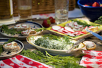 Using herbs, dill butter in a picnic with radish sandwiches