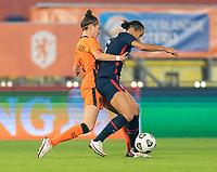 BREDA, NETHERLANDS - NOVEMBER 27: Dominique Janssen #20 of the Netherlands defends Lynn Williams #6 of the USWNT during a game between Netherlands and USWNT at Rat Verlegh Stadion on November 27, 2020 in Breda, Netherlands.