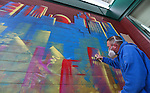 Artist Bryce Chisholm works on his mural at Greater Nevada Field, in Reno, Nev., on Wednesday, March 30, 2016. <br /> Photo by Cathleen Allison