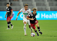 WASHINGTON, DC - JULY 7: Griffin Yow #22 of D.C. United  battles for the ball with Barlon Sequeira #22 of Liga Deportiva Alajuense during a game between Liga Deportiva Alajuense  and D.C. United at Audi Field on July 7, 2021 in Washington, DC.