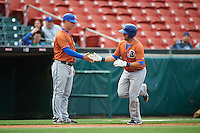 Durham Bulls manager Jared Sandberg (left) congratulates J.P. Arencibia (16) after hitting a home run during a game against the Buffalo Bisons on June 13, 2016 at Coca-Cola Field in Buffalo, New York.  Durham defeated Buffalo 5-0.  (Mike Janes/Four Seam Images)