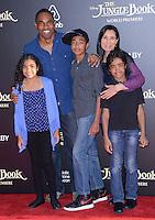 Jason George + family @ the premiere of 'The Jungle Book' held @ El Capitan theatre.<br /> April 4, 2016