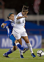 Ana Martinez of Guatemala (L) and Carli Lloyd of USA (R) at the 2010 CONCACAF Women's World Cup Qualifying tournament held at Estadio Quintana Roo in Cancun, Mexico.