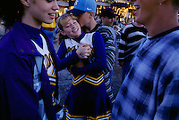 "After participating in the cheerleader contest, teens meet their boyfriends in the midway to cuddle at the Cullman County Fair in Alabama. Texas fair manager Anita Rogers says, ""Many young hearts have been stolen at a county fair."""