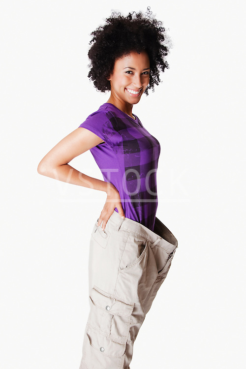 USA, California, Fairfax, Portrait of young woman with loose pants