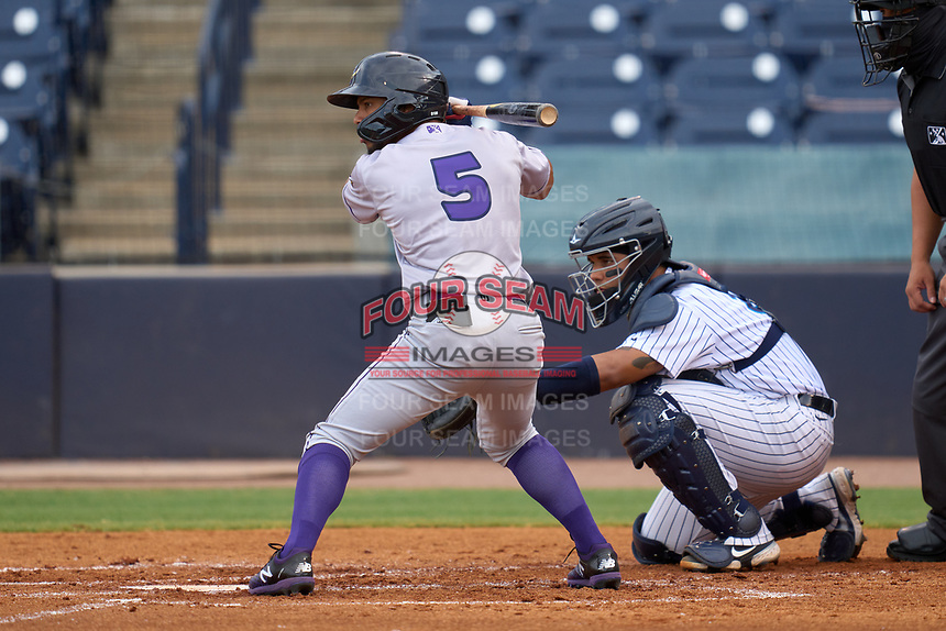 Fort Myers Mighty Mussels outfielder Jeferson Morales (5) bats in front of catcher Carlos Narvaez (5) during a game against the Tampa Yankees on May 19, 2021 at George M. Steinbrenner Field in Tampa, Florida. (Mike Janes/Four Seam Images)