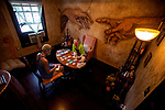Amanda Lyn ,a tarot and Oracle Reader, reads cards with customer Kristal Jones on the second floor of the Hotel Cassadaga in Cassadaga, Florida. The Hotel Cassadaga is a 1920s era hotel that is haunted by friendly spirits in the center of this spiritualist community established in 1894. <br /> Cassadaga is the psychic center of the South and is registered as a historic site.