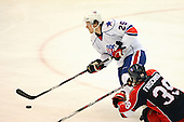 December 30th, 2007:  Jordan Henry (25) of the Rochester Amerks controls the puck during the third period of play.  The Syracuse Crunch shutout the Rochester Amerks 4-0 to earn the win at Blue Cross Arena at the War Memorial in Rochester, NY.  Photo Copyright Mike Janes Photography 2007.