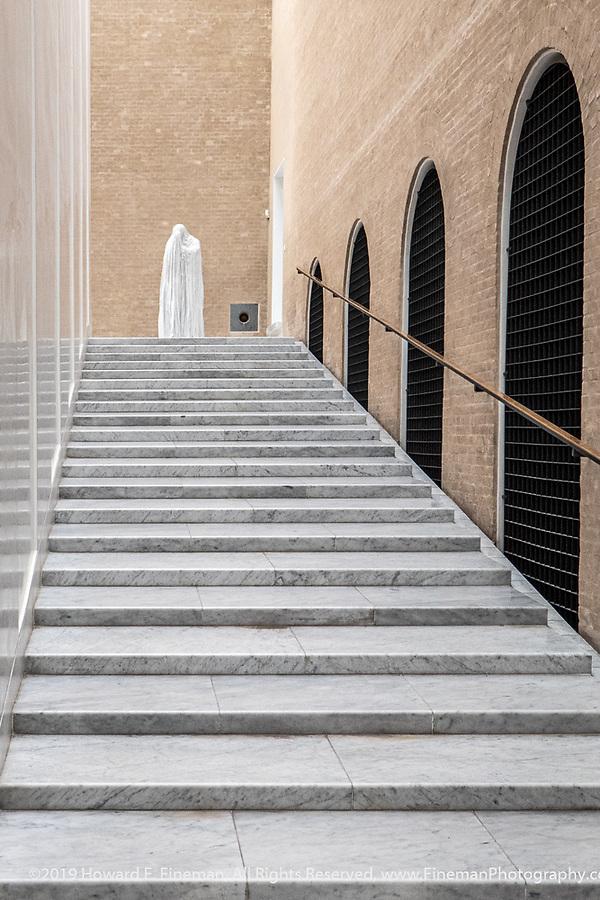 Stairs and solitary sculpture in the Carlsberg Glyptotek museum